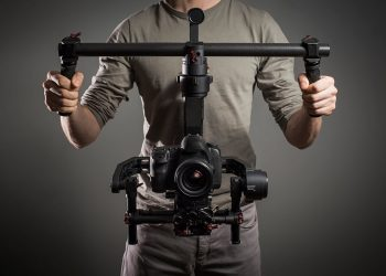 man holding camera with stabilizer and gimbal