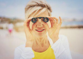 lady using small binoculars