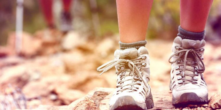 a pair of feet wearing hiking boots