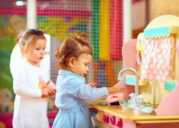 kid playing on kitchen set