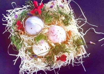 bath bombs placed on a nest-like wooden