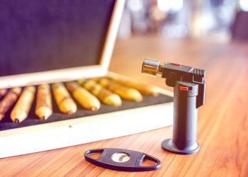 luxury cigar set with lighter on the wooden table