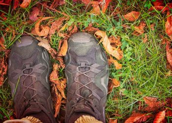 hiking boots outside on the grass
