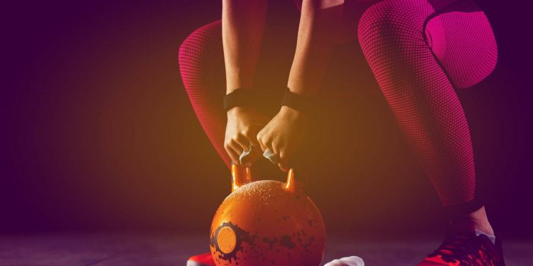 fitness woman working with kettlebell