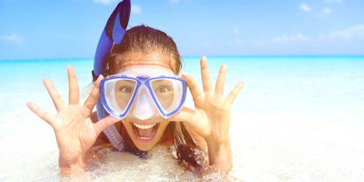 woman wearing a snorkel scuba mask making a goofy face