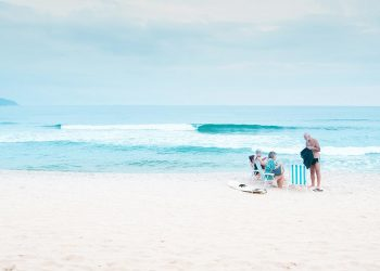 3 elderly people at the beach