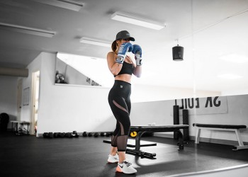 woman in the gym with boxing gloves on