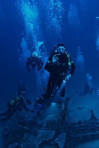 divers blowing bubbles